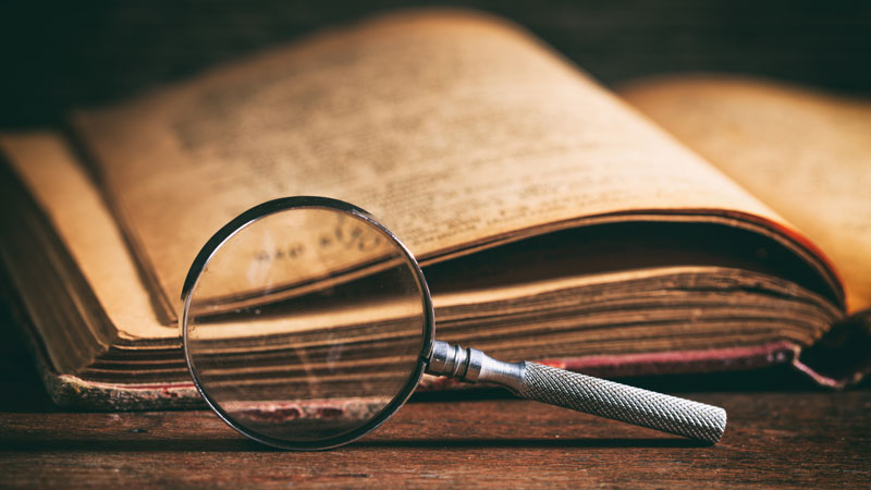 Old-Book-and-Magnifying-glass