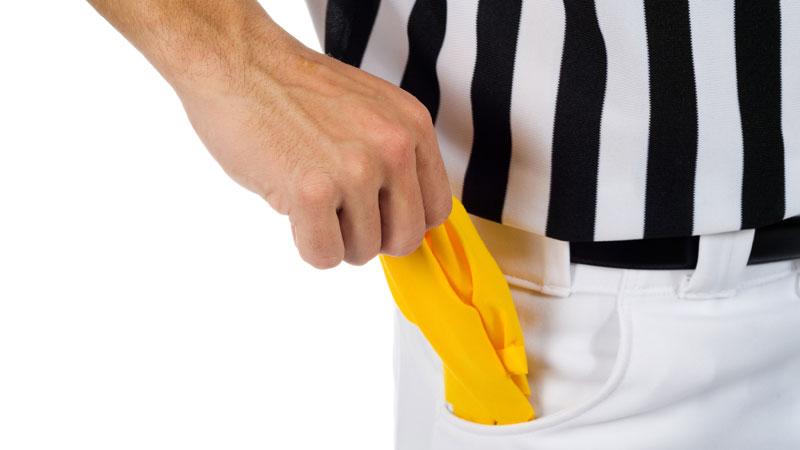 Referee-pulling-out-penalty-flag